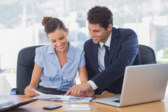 Smiling business people working together Royalty Free Stock Image