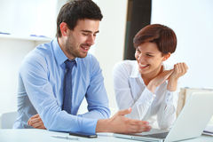 Smiling business people working together in the office Royalty Free Stock Photo