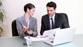 Smiling business people working together. In their office stock video footage
