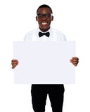 Smiling business representative holding whiteboard Stock Images