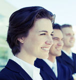 Smiling business team. Head and shoulders of three business people looking in same direction smiling Royalty Free Stock Image