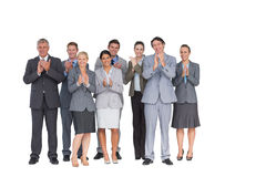 Smiling business team applauding at camera Royalty Free Stock Photos