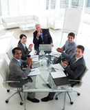 Smiling business team applauding in a meeting Stock Photo
