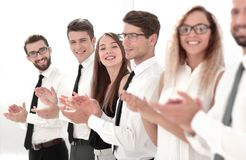 Smiling business team applauding standing royalty free stock photography