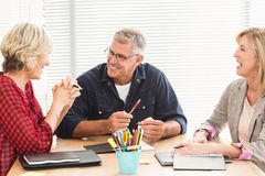 Smiling business team attending a meeting Royalty Free Stock Photos
