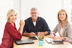 Smiling business team attending a meeting Royalty Free Stock Image