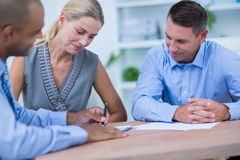 A smiling business team brainstorming together. In the office Stock Image