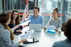 Smiling business team discussing in a meeting Stock Photography