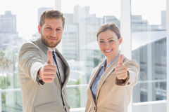 Smiling business team giving thumbs up Royalty Free Stock Photography