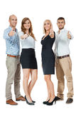 Smiling business team group together thumbs up isolated Royalty Free Stock Images