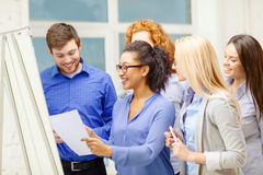 Smiling business team having discussion in office Royalty Free Stock Photography