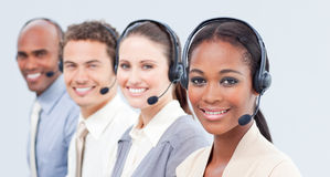 Smiling business team with headset on Royalty Free Stock Photo
