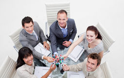Smiling business team holding molecules Stock Photo