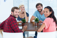 Smiling business team looking at the camera Stock Images