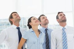 Smiling business team looking up Stock Images