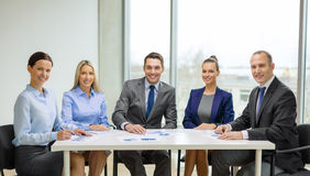 Smiling business team at meeting Stock Photo