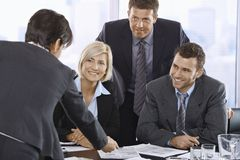 Smiling business team in meeting room Royalty Free Stock Photos