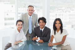 Smiling business team in an office Stock Photos