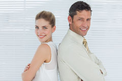 Smiling business team posing back to back Stock Photography