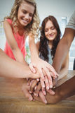 Smiling business team putting their hands together Royalty Free Stock Images