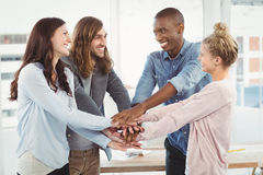 Smiling business team putting their hands together Royalty Free Stock Photography