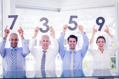 Smiling business team showing paper with rating Royalty Free Stock Image