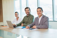 Smiling business team sitting in conference room Stock Photography