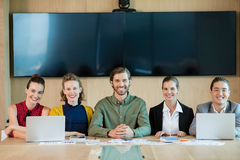 Smiling business team sitting in conference room Royalty Free Stock Image