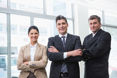 Smiling business team standing with arms crossed Royalty Free Stock Photo