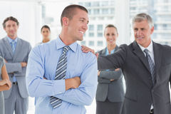 Smiling business team standing with arms crossed Stock Image