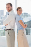Smiling business team standing back to back Stock Photo