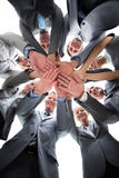 Smiling business team standing in circle hands together Royalty Free Stock Images