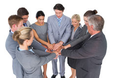 Smiling business team standing in circle hands together Stock Photography