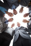 Smiling business team standing in circle Royalty Free Stock Image