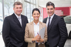 Smiling business team standing in a line Stock Photography