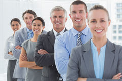 Smiling business team standing in a line Royalty Free Stock Photography