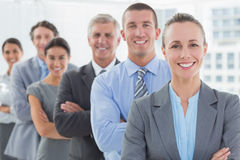 Smiling business team standing in a line. In the office Royalty Free Stock Images