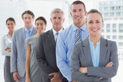 Smiling business team standing in a line. In the office Royalty Free Stock Photos