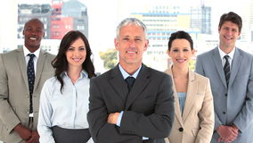 Smiling business team standing together with arms crossed Royalty Free Stock Photo