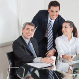 Smiling business team at table Royalty Free Stock Image