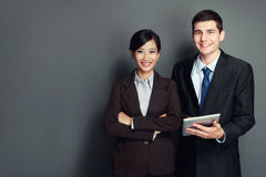 Smiling business team with tablet pc Royalty Free Stock Photo