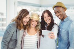 Smiling business team taking selfie at office Royalty Free Stock Image