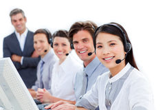 Smiling business team talking on headset. In a call center Royalty Free Stock Photo