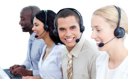 Smiling business team talking on headset Royalty Free Stock Photo