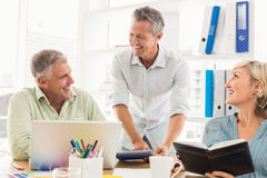 Smiling business team talking in a meeting Royalty Free Stock Photos