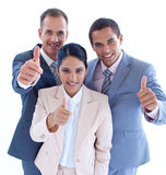 Smiling business team with thumbs up Stock Image