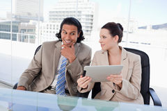 Smiling business team using a tablet computer Stock Photos