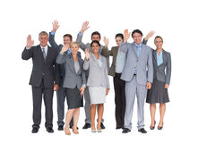 Smiling business team waving at camera Royalty Free Stock Images