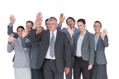 Smiling business team waving at camera. On white background stock photos