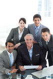 Smiling business team working at a computer Stock Image